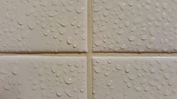 Close up of grout and wet tiles