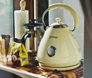 Creamy yellow coloured electric kettle on a kitchen bench