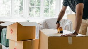 Man packing boxes in his lounge