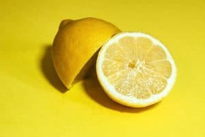 Big, juicy lemon on a yellow background