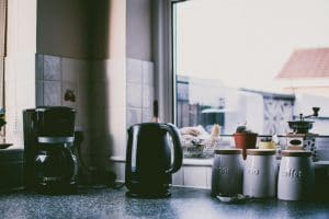Coffee maker and kettle on kitchen bench top