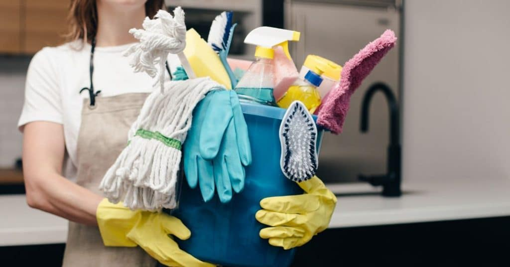 Cleaner holding bucket of cleaning materials